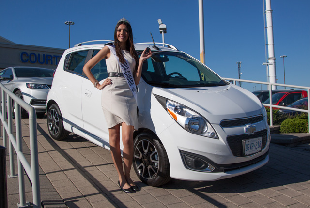 Miss India Canada Harleen Malhans with her Chevrolet Spark