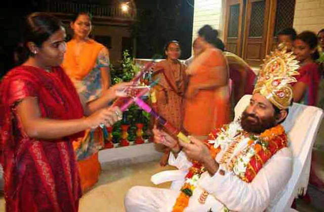 Narayan Sai, who has admitted to sexual relations with eight female disciples, is seen playing Dandia Raas with a female devotee at his ashram