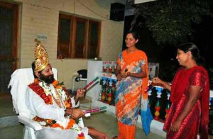 Narayan Sai seen with two female devotees