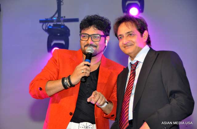 President Harish Bhatt joins singer Babul Supriyo on stage to thank the audience