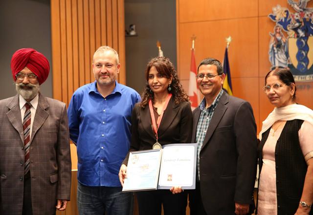 L to R - WIN Distinguished poet Award for book titled Ikk Diva Ikk Dariya. Mr. Badal, Alan Hill, Tandeep Tamanna, Ashok Bhargava and Mrs. Badal.