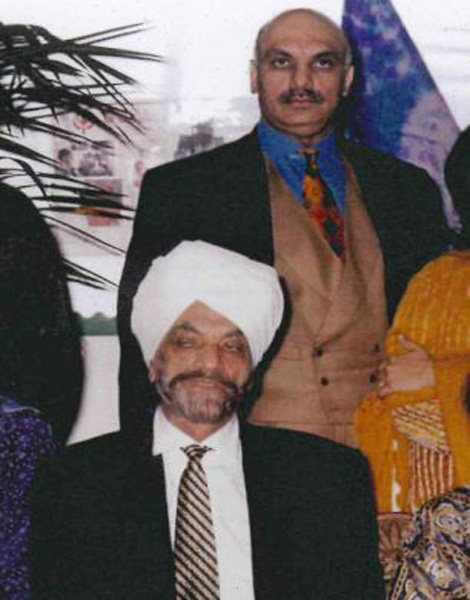 Bal Mohinder Singh (sitting) seen with his son Jasminder Singh (standing). Photo courtesy Daily Mail