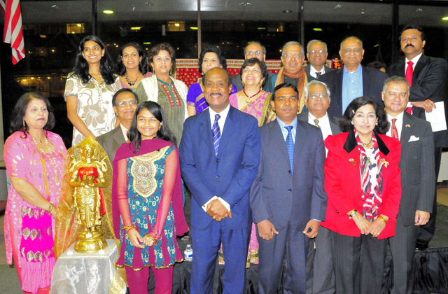 Montgomery County Executive Ike Leggett posing with those who came to celebrate Diwali.