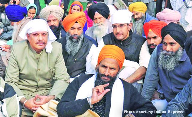 Gurbaksh Singh Khalsa (saffron turban)