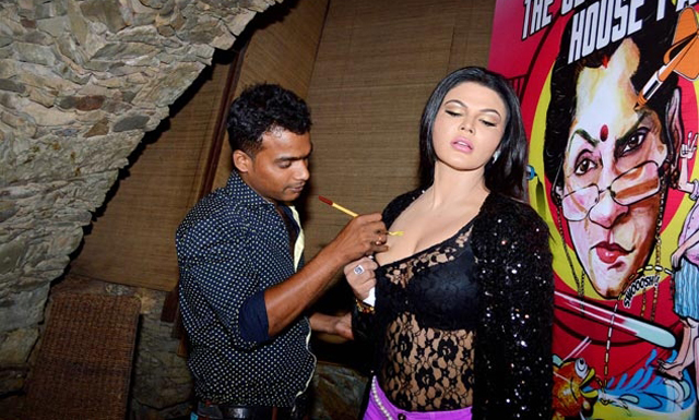 Rakhi Sawant gets What The Fish sign during the promotion of the film