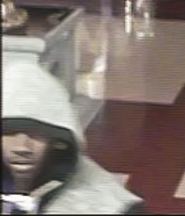 Black male robbery suspect caught on security camera at the Scarborough Hindu temple.