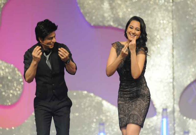 Sonakshi (right) dancing with Shahrukh Khan