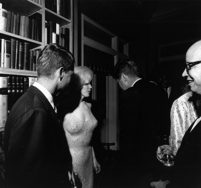 This picture of May 19, 1962, shows Marilyn Monroe in the middle of Robert Kennedy (left) and President Kennedy (back to the camera) at the President's birthday party at Arthur Krim's house, New York. (Photo courtesy the John F. Kennedy Presidential Library and Museum, Boston)
