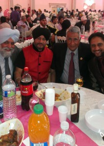 Author Balwant Sanghera (second from right) at a Punjabi wedding in Paris.