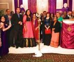 Shusmita Sharma lighting the lamp with dignatories