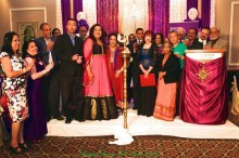 Shusmita Sharma lighting the lamp with dignatories