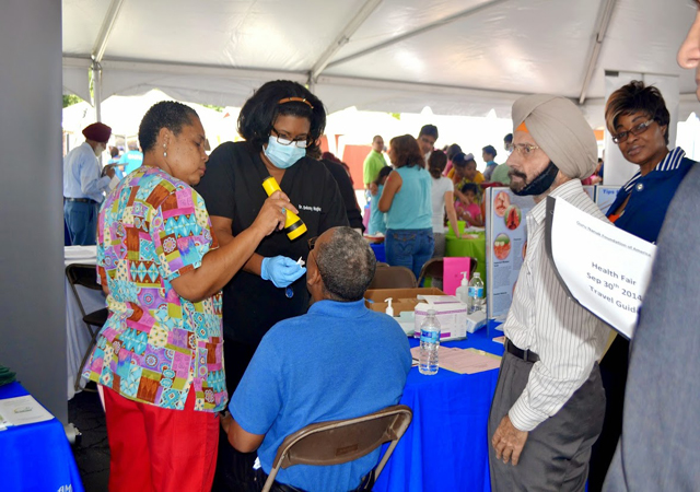 Doctors examining people at the health fair.