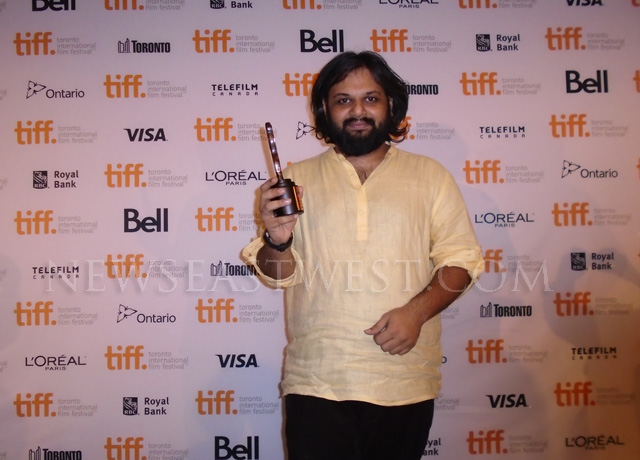 Nilesh Maniyar - co-producer of Margarita, With a Straw - with the TIFF award in Toronto on September 14.