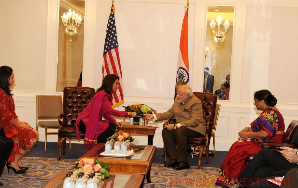 Hindu Congresswoman Tulsi Gabbard presents her personal copy of Gita to Modi