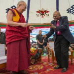 Archbishop Desmond Tutu dances with the Dalai Lama in Dharamsala