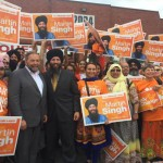 Martin Singh seen with his leader Tom Mulcair and supporters.