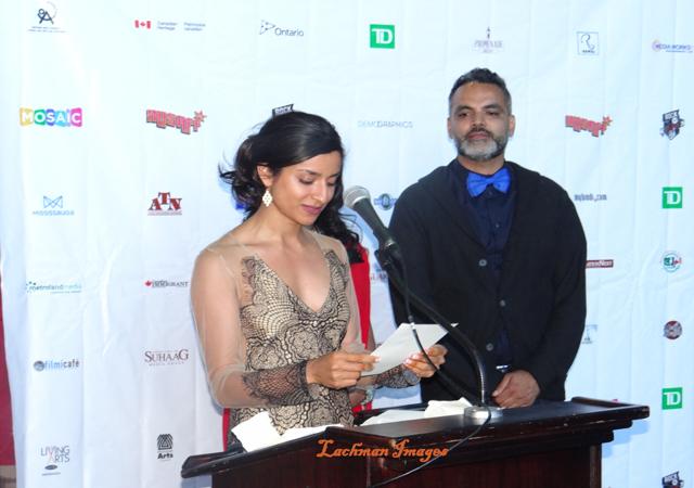 Supinder Wraich announcing an award