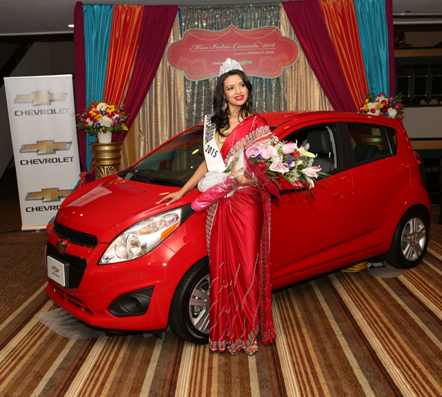 Miss India-Canada Manasvi Noel with her prize car.