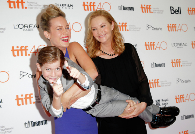 Actress Brie Larson holds Jacob Tremblay, who plays her son Jack in the film Room, during the premiere of the film at Toronto international film festival. Actress Joan Allen is on the right. TIFF photo by Joe Scarnici/Getty Images