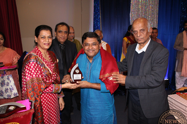 Amrit Mangat honouring Narendra Datar. Dr Lakshamanan is on extreme right.