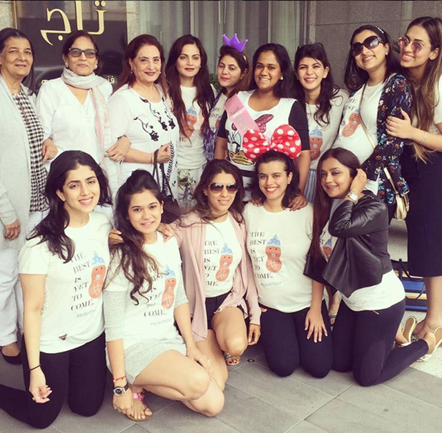 Arpita with family and friends at her baby shower