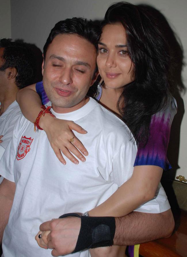 Priety Zinta holds Ness Wadia tight.