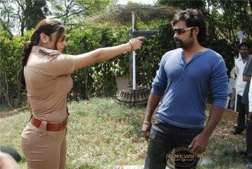 South Indian sex bomb Namitha in the cop role in the Telugu film Desadrohi (2010)
