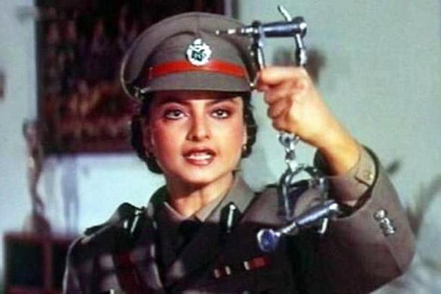 Rekha as a policewoman in Phool Bane Angaray