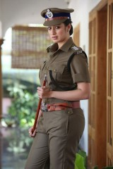 Glamorous south Indian actress Lakshmi Rai in a cop role.