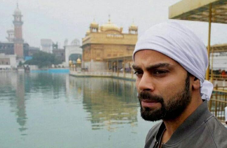 Cricket star Virat Kohli prays at the Golden Temple