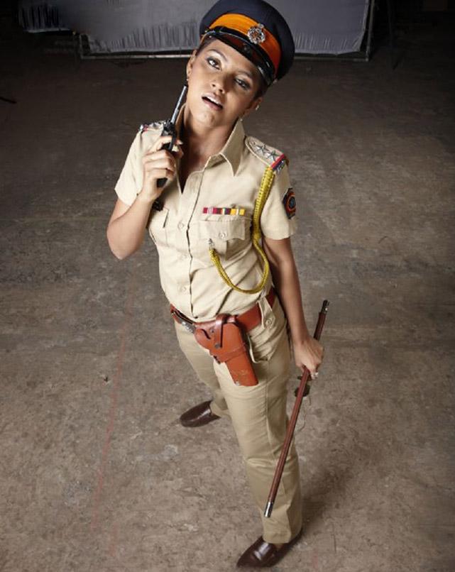 Neetu Chandra as Inspector Mayawati Chautala in the 2008 film One Two Three
