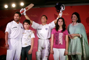 Cricketer Sachin Tendulkar with his family at the unveiling of his wax statue at Madame Tassauds