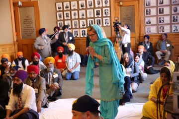 Ontario Premier Kathleen Wynne offers prayers as the Sikh holy Guru Granth is brought for the first time to  Ontario assembly for Vaisakhi prayers on April 18