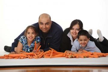 carrot farmer amrik sahota with his family and farm produce