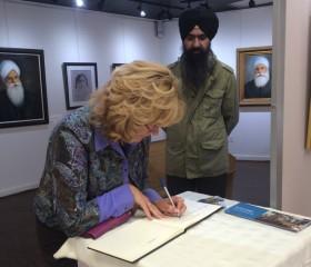 Brampton mayor Linda Jaffrey signs the guest register at Kulwant Singh's exhibition