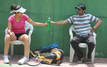 Indian tennis star Sania Mirza with her Pakistani husband Shoaib Malik