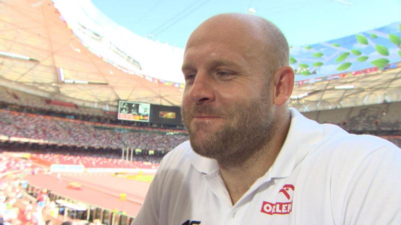 Olympic champion discus thrower Piotr Malachowski donates medal to poor boy