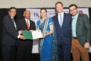 Canada's science minister Kirsty Duncan presenting a certificate of recognition to IITAC conference chairman Arun Chockalingam in Toronto. Photo by Prasad Bettadapura
