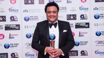 Bob Dhillon with the award