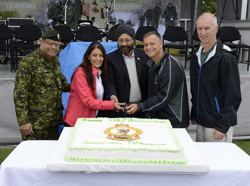 Surjit Babra and his wife at a Canadian armed forces event. Extreme left is Lt-Col 9hinorary) Hari Panday. Col. J.R.M. Gagné, Commander of 4th Canadian Division Support Group at Petawawa, and his Chief Warrant Officer W.A. Richards are on the right.