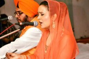 Amruta Fadnavis, wife of Maharashtra chief minister, singing a hymn at Mumbai's Santa Curz gurdwara on the 350th birth anniversary of the 10th Sikh Guru Gobind Singh.