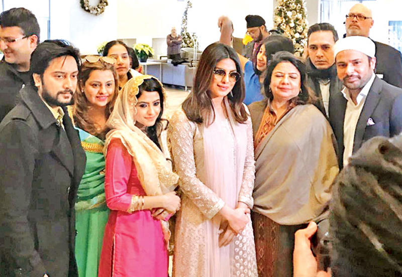 Priyanka Chopra seen in Toronto with her mother (to her left) Madhu Chopra, Amrinder Gill, Simi Chahal with Deepshikha Deshmukh for the promotion of her Punjabi production Sarvann.