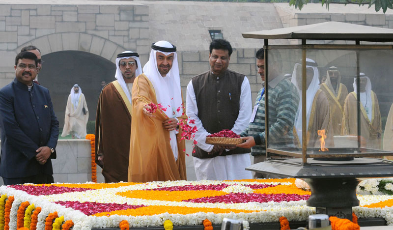 The Crown Prince of Abu Dhabi, Deputy Supreme Commander of U.A.E. Armed Forces, General Sheikh Mohammed Bin Zayed Al Nahyan paying tributes at the Samadhi of Mahatma Gandhi, at Rajghat, in Delhi on January 25. The Minister of State for Petroleum and Natural Gas (Independent Charge), Shri Dharmendra Pradhan is also seen.