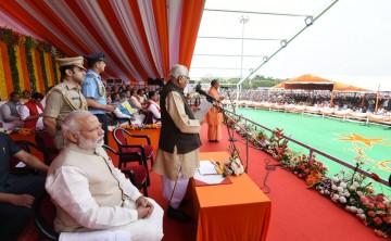 Ygi Adityanath seen taking the oath as chief minister of Uttar Pradesh. Prime Minister Narendra Modi is in the foreground.