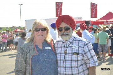 Darshan Kang with a supporter during his poll campaign.